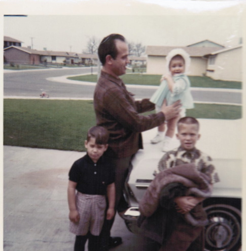 My favorite picture-Dad, Justin, Donny and me (9 Months old) standing on the hood of dad's car. Sacramento, CA